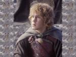 Mit wem reitet Merry zur Schlacht um Minas Tirith?