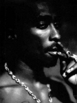Wie heißt Tupac Amaru Shakur's leiblicher Vater?