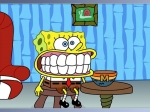Spongebob hat ein Gebiss im Mund, dass als Überraschung in einer Cornflakes-Packung war.