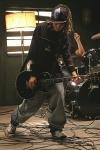 Welches war das erste Lied, das Tom auf der Gitarre spielen konnte?