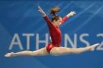 Wer war die 1. Amerikanische Turnerin, die bei den Olympischen Spielen die Goldmedaille holte?
