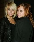 Wie ist der Name der eigenen Firma der Olsen-Zwillinge?