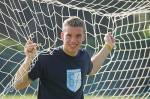 Wann hatte Poldi sein erstes Länderspiel?