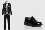Die Schuluniform für Jungs besteht aus einem weißen Hemd mit einer dunkelblauen, langen Krawatte und einem schwarzen Jackett. Dazu trägt man eine s